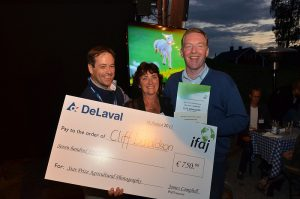 Overall Winner (Cliff Donaldson, Northern Ireland, accepted on his behalf by Richard Halleron, Ireland). On the right: Benoit Passard of DeLaval and Executive Secretary Connie Siemes. Picture taken by Chuck Zimmerman.