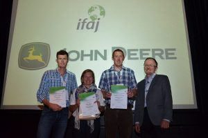 From left to right: Nathan Dyer, who achieved honourable mention, British Guild chair person Jane Craigie who collected the top prize won by Mike Abram, Darren Carty collecting the runner-up award on behalf of Catriona Murphy of Ireland and Markus Rediger, president of IFAJ.