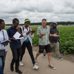 Eunice Ndhlovu of Malawi (left), Koleta Makulwa of Tanzania (in hat) and Jefferson Massah of Liberia (far right) of the 2018 IFAJ/Corteva Agriscience Master Class and Joseph Gakpo of the IFAJ/Alltech Young Leaders program (second from left) interview a Dutch farmer during last year's Boot Camp program.